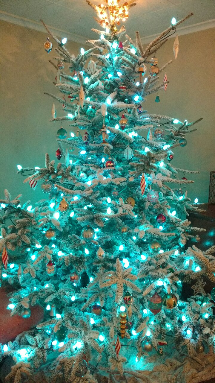 Flocked tree with lights and ornaments
